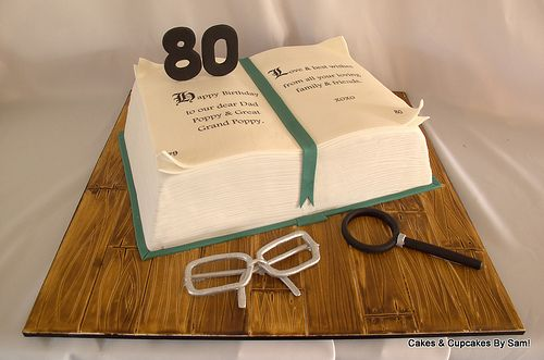 80th Birthday but with crosswords puzzle and a deck of cards on side.