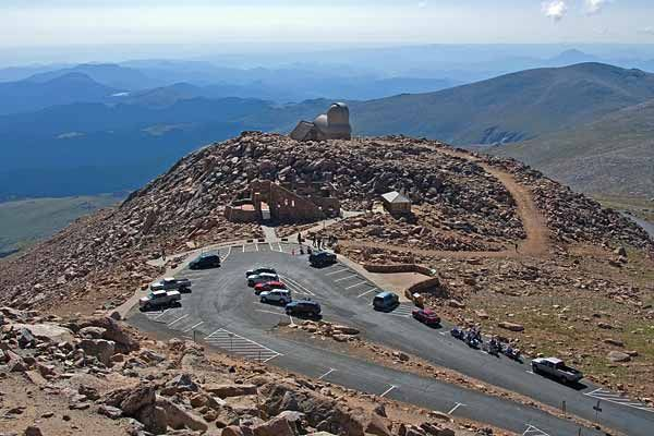 The Mount Evans Scenic Byway begins at the junction of Interstate 70 and State Highway 103 near Idaho Springs, Colorado and continues on State Highway 5 through a corridor between the Mount Evans Wilderness where it ends near the summit of Mount Evans. The byway is 28 miles (45 km) in length and gains over 7,000 feet (2,100 m) of elevation. Achieving a final elevation of 14,130 feet (4,310 m), this is the highest paved road in North America.