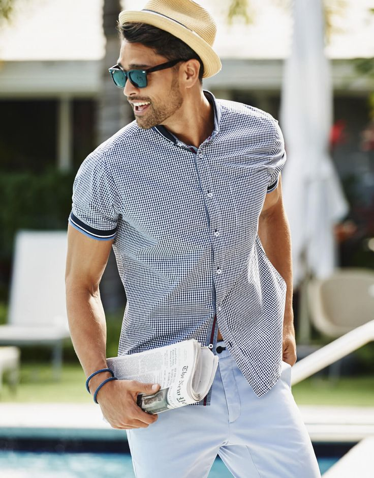 Does your father love fashion? Treat him to a stylish short sleeve men's button up shirt with stripe collar and knit trim paired with blue hue pants from Winners.