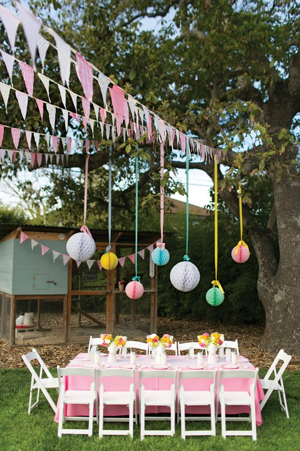 Lovely garden tablescape with hanging tissue honeycomb & bunting