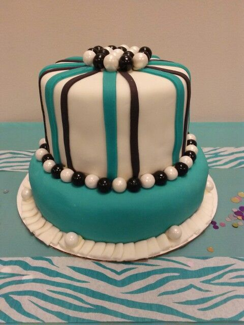 Teal cake with gumball pearls that I made for a coworkers 30th B-day.