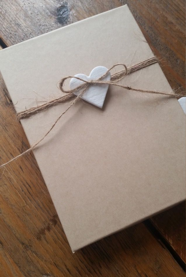 gift with a small clay heart and twine wrapping