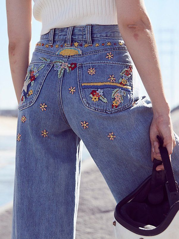 Courter Embroidered Flare | Inspired by decades past, these high rise denim flares feature beautiful embroidery along the front and back pockets. Rigid cotton fabrication and relaxed wide leg silhouette makes for a classic fit. Five-pocket styling and zip fly with single button closure. Frayed hem.