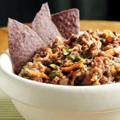 Checkout this easy Black Bean Dip Recipe at LaaLoosh.com. With just 1 Point Total, this low calorie, spicy black bean dip is a wonderful weight watchers appetizer recipe to serve at parties. It's the perfect low calorie snack idea!