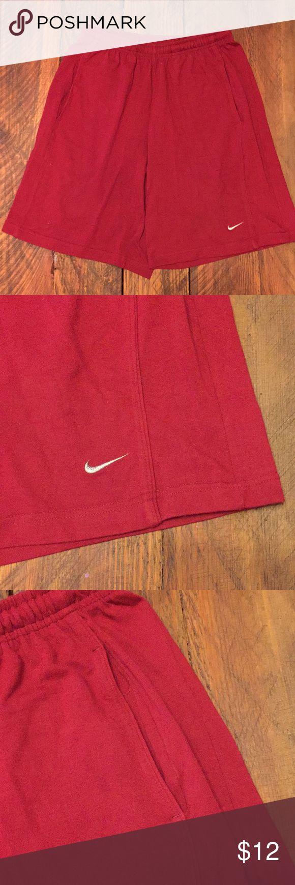 Nike cotton shorts in men's large Nike cotton shorts in men's large.  Garnet/deep red in color.  Nike swoosh on lower left leg.  Drawstring waist and pockets. Nike Shorts