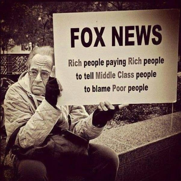 sign: FOX News:  Rich people paying Rich people to tell Middle Class people to blame Poor people