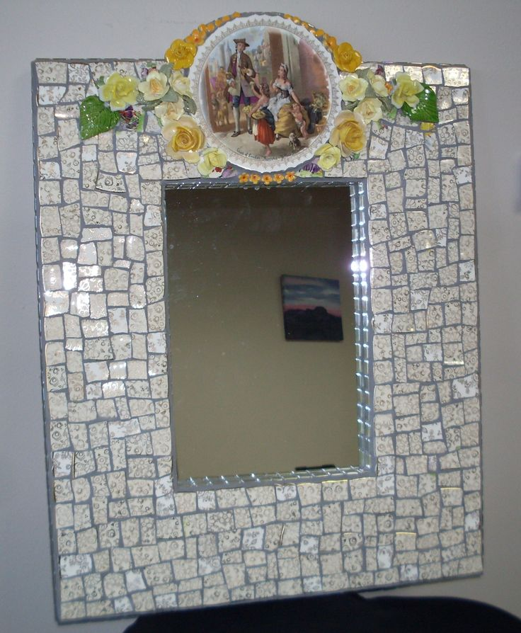 Made this mosaic mirror frame with broken china and porcelain flowers. Edges are glass mosaic tiles