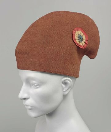 A phrygian cap is a red hat that was a symbol of support for the French Revolution. It is also called a bonnet rouge.