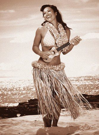 Hula girl in a grass skirt with an ukulele.