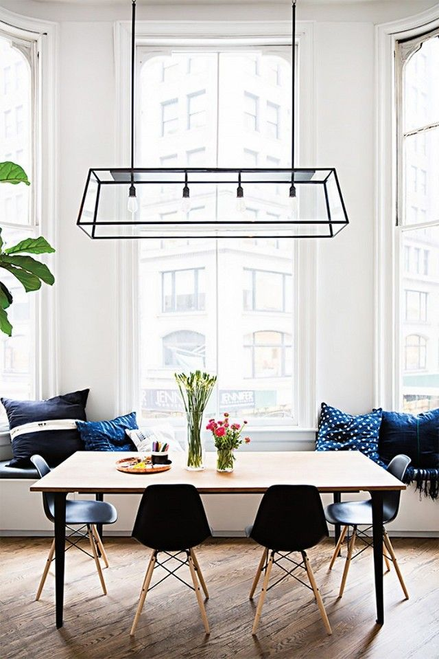 Bright dining space with a large pendant light, and a bench