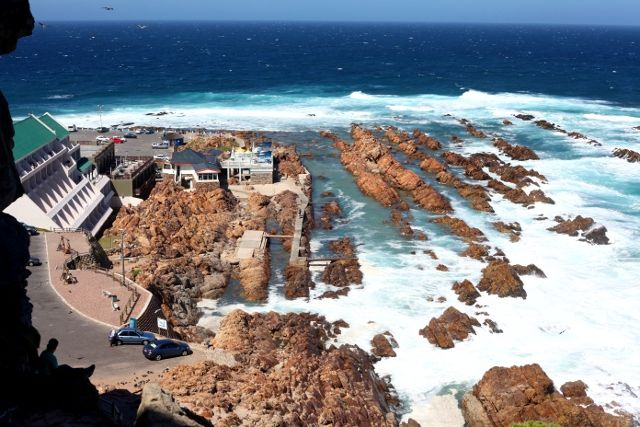 View from Cape St Blaise lighthouse, in Mossel Bay, South Africa. The rocks below contain the best tidal pool I've swum in.