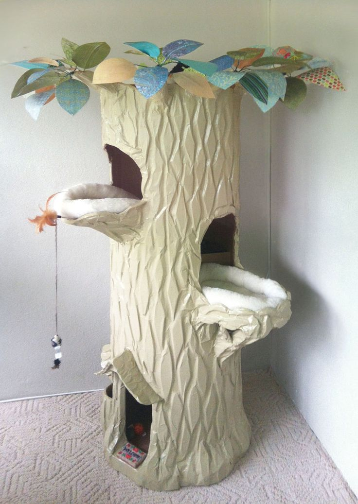 6 feet tall - I make these spiral staircase cat houses and ship them all around the world. $1,500-gaylewray@yahoo.com