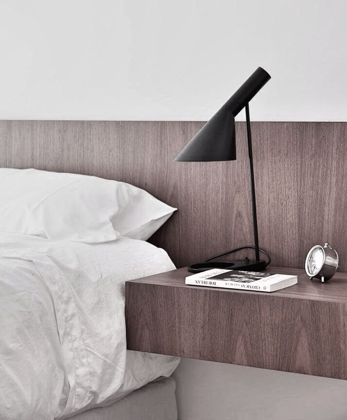 AJ lamp, clean headboard with built-in night tables