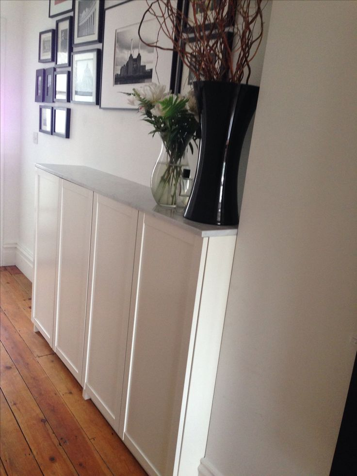 Billy bookcases for hallway shoe storage, topped with marble