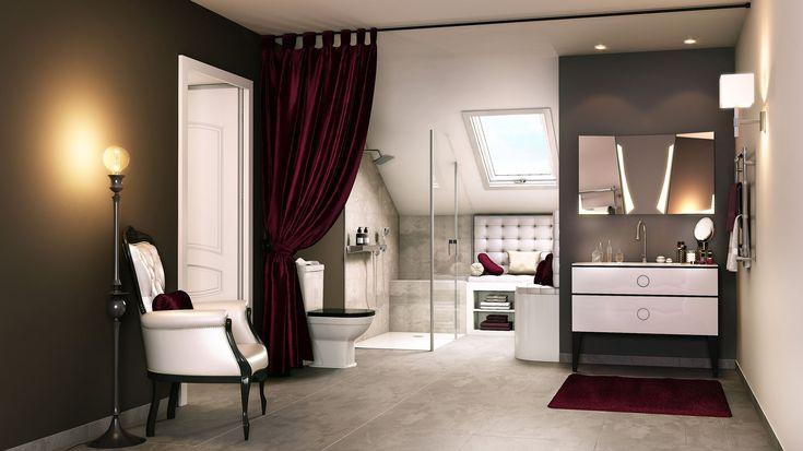 Le meuble signe ce style Néo-classique surligné d'une robinetterie en forme de goutte d'eau. Le radiateur sèche-serviette et les WC sont de forme beaucoup plus classiques.   Une salle de bain au style original !