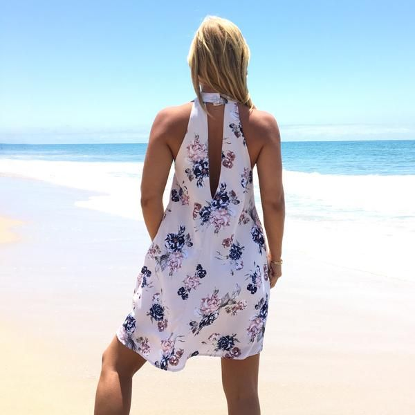 Beautiful cream & blue hue florals throughout, dress features a high neckline with a modest cut out back & single button closure behind the neck. Dress