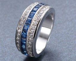 Luxusný prsteň zo zliatiny bieleho zlata s modrými zirkónmi