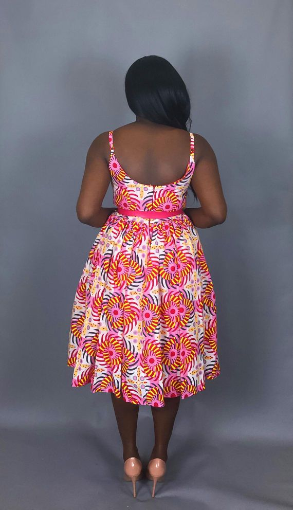 Sometimes less is more, This simple yet classic tea length dress is the perfect dress for just that occasion.In an eye popping color pattern,this is a perfect addition to your wardrobe. Made with authentic Vlisco wax print. Fully lined with pockets for your convenience. XS – Bust:32