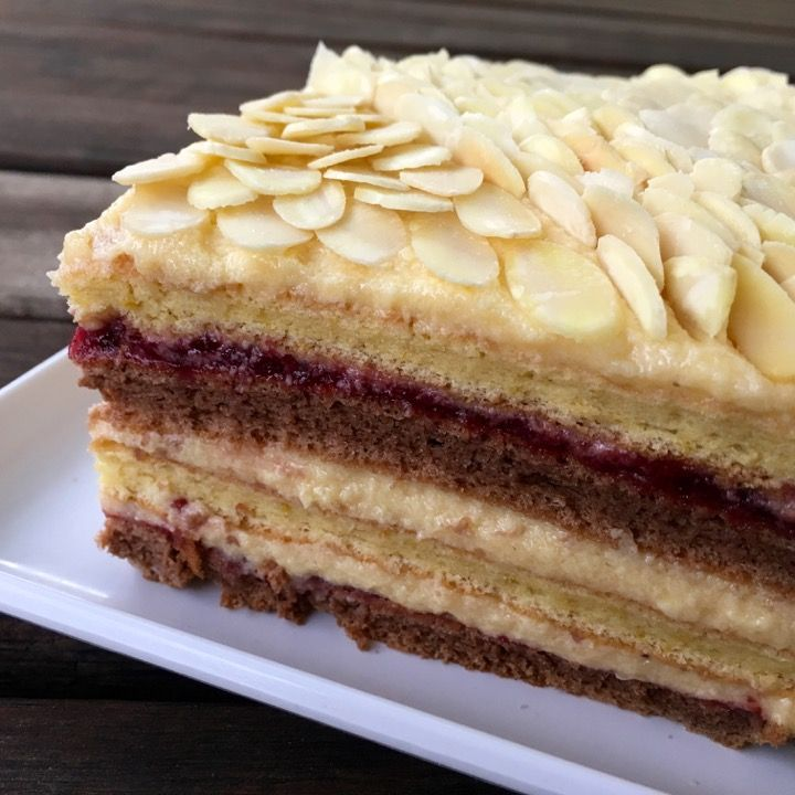 Traditional Latvian sponge cake with cranberry jam and custard filling