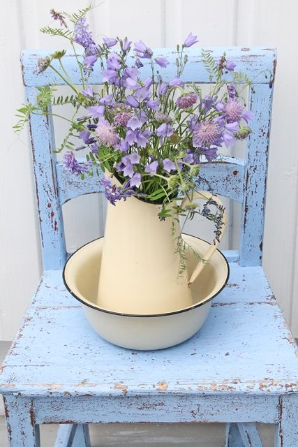 Ahhh so shabby chic...pale purple flowers on a blue chippy chair with a vintage enamelware pitcher and bowl.. So Sweet! ♥ Love ♥