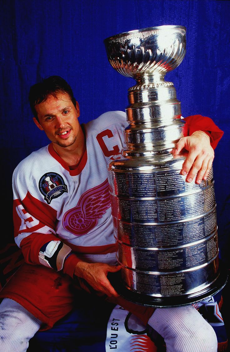 Steve Yzerman, a true champion, with the Stanley Cup(s), the scars and missing tooth to prove it.