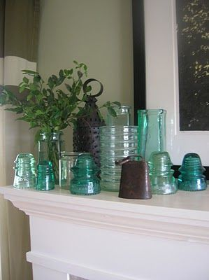 Like the arrangement of glass.  I  bought some of these(INSULATORS-GOD FORBID I don't use the proper name, or random strangers will take it upon themselves to correct me[glass caps from electricity poles]).  the other day from the Antique Box in Elloree SC-best kept secret in the south. Here's a way to display-cute