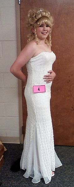 Outstanding! This is a junior at a Tennessee high school pageant. And the hell of it is: HE DIDN'T WIN!! Alas, sometimes in these things it's not the prettiest or most feminine that wins, but someone more popular overall, or who had a better talent segment, or whatever.: