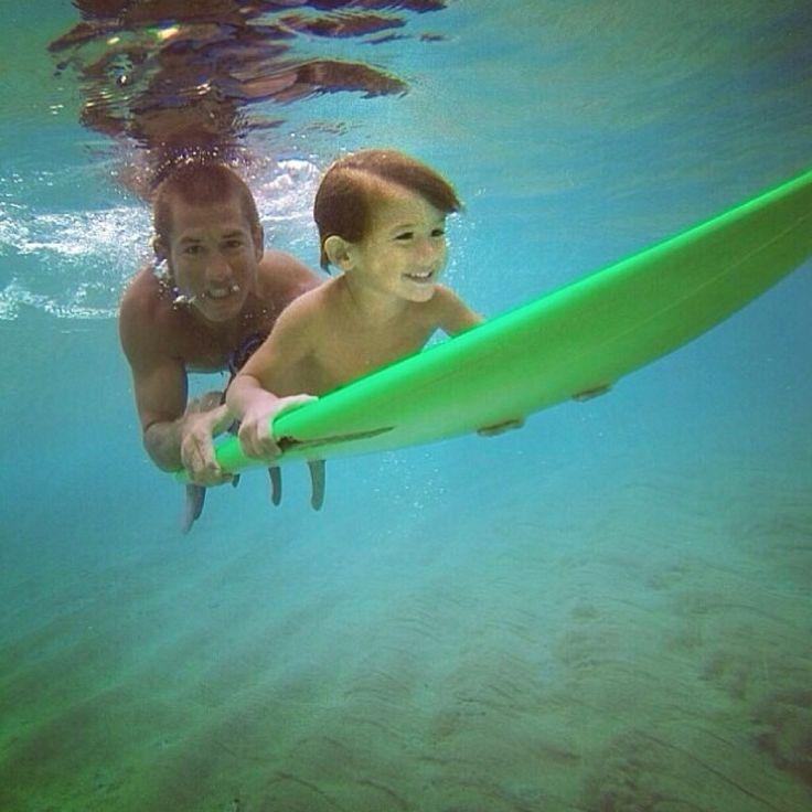 Cru Suratt & his son, Takoda. Cru teaches surf lessons at surfnorthshore.com