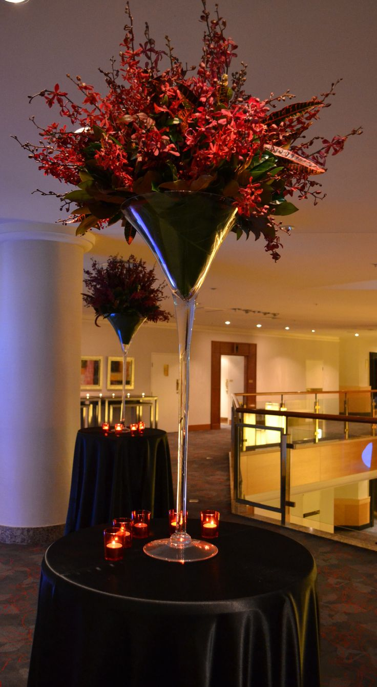 Large martini vase filled with red spider orchids for pre dinner drinks area. Styled by Greenstone Events.