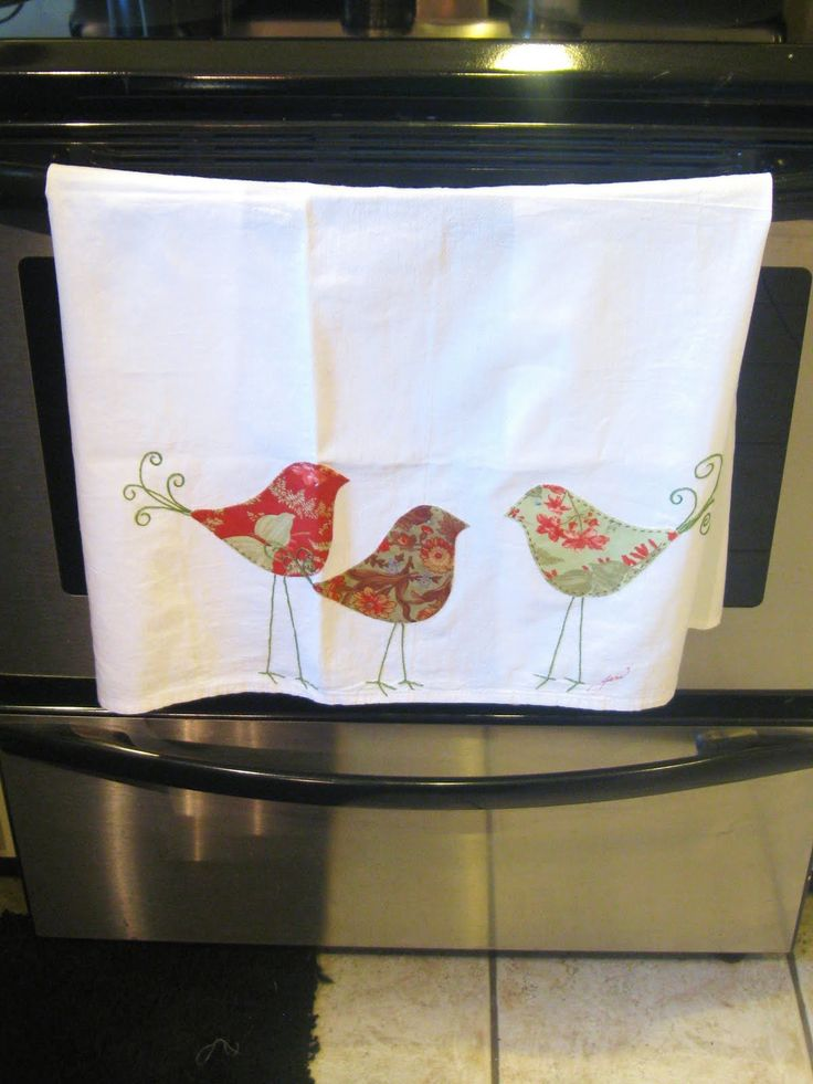 A cute little spring dish towel using your scraps of cute fabric.    1-cut any shape out of scraps of fabric (we chose birds)  2- Use Iron-o...