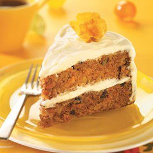 Magnificent Carrot Cake Recipe -If you're looking for something a little more traditional, nothing says Easter like a homemade carrot cake covered in rich cream cheese frosting. A touch of rum extract lends wonderful flavor to every bite of this baked-from-scratch indulgence.—Melanie Madeira, Dallas, Pennsylvania