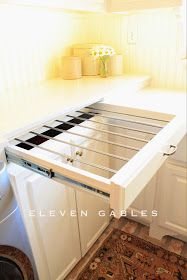 A pull - out clothes drying rack fitted with a drawer front. This takes up a lot less room than a drying rack and it's hidden when not in use. How great is this? So doing this!
