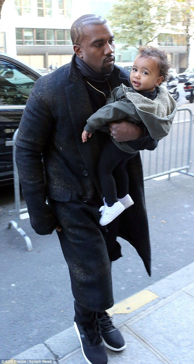 Kanye West toted baby North as the Wests arrived in Paris for fashion week http://dailym.ai/1sXLswe