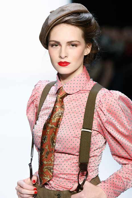 Menswear for women.  Pink silk Victorian style blouse with polkadots.  Newsboy cap, suspenders and trowsers in olive. Love!