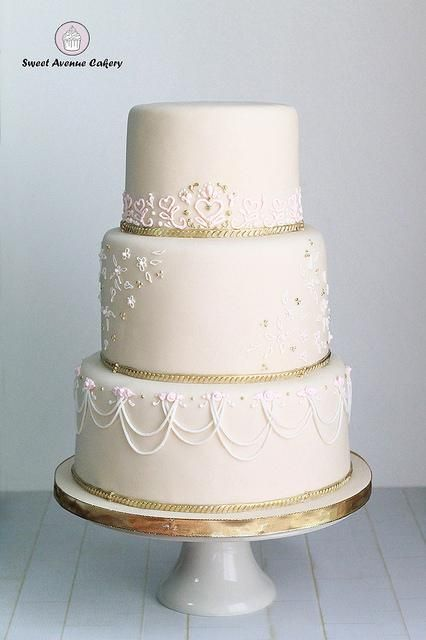 Elegant Lace Wedding Cake in ivory and peach with gold accents delivered to the Scottish Rite in Hamilton Ontario for the wedding of Annie and Nathan. Congrats guys!!! #weddingcake #ivorywedding #scottishrite