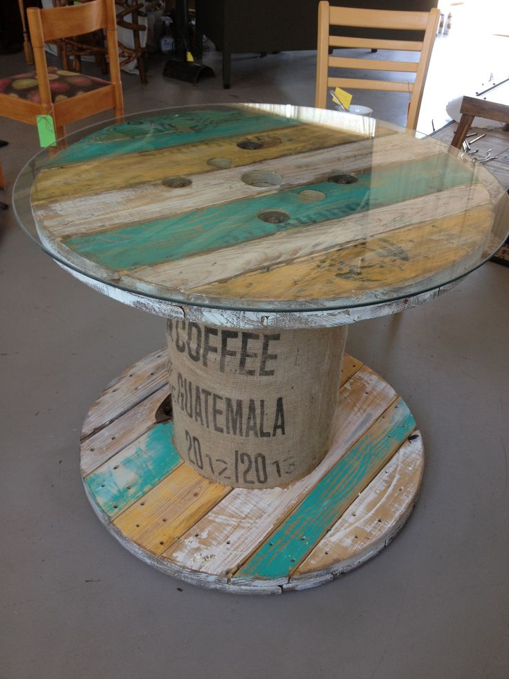 I transformed this spool into a colorful, functional table, with a nice glass top.  It could be a table to sit around, or as nice addition to a room to hold a lamp and some books.