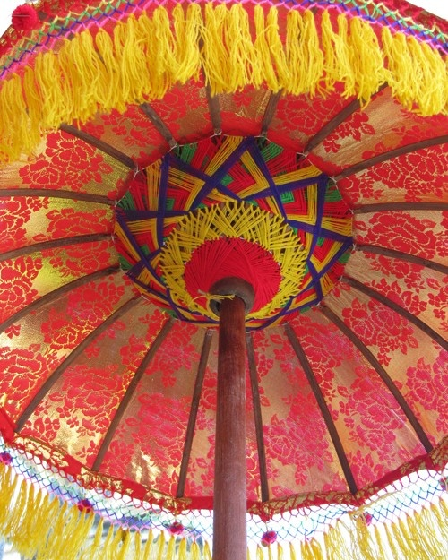 This photograph was taken of a decorative ceremonial umbrella at a Hindu temple in Bali, Indonesia.