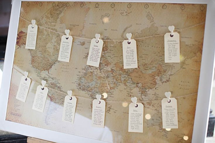 World map themed wedding table plan. More map seating plan ideas at http://www.toptableplanner.com/blog/world-map-wedding-seating-plans