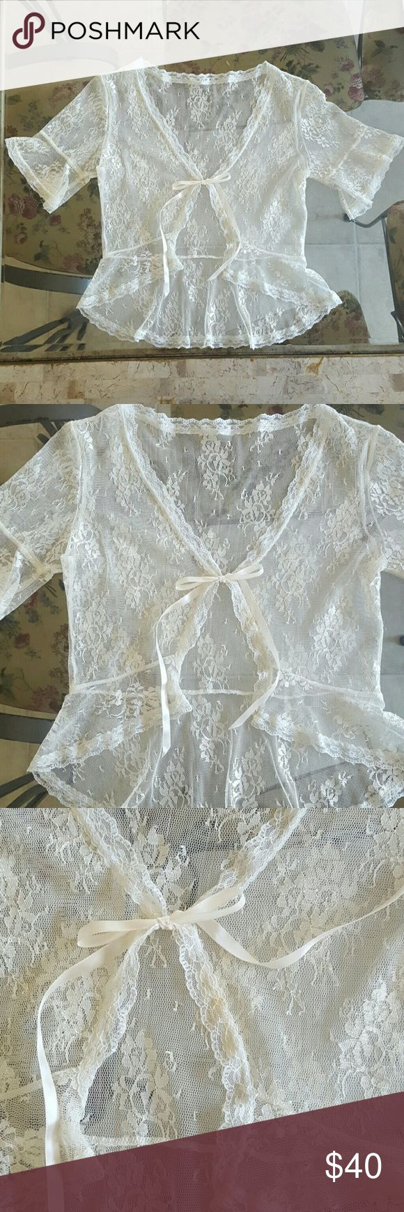Beautiful vintage American Rag lace shawl/top Bought it in Macys with that small stain which can be removed, the brand is American Rag I removed because it is see through. Planned to use it once but never did. Vintage looking shawl!!! Great for a wedding dress or under tanks!! American Rag Tops