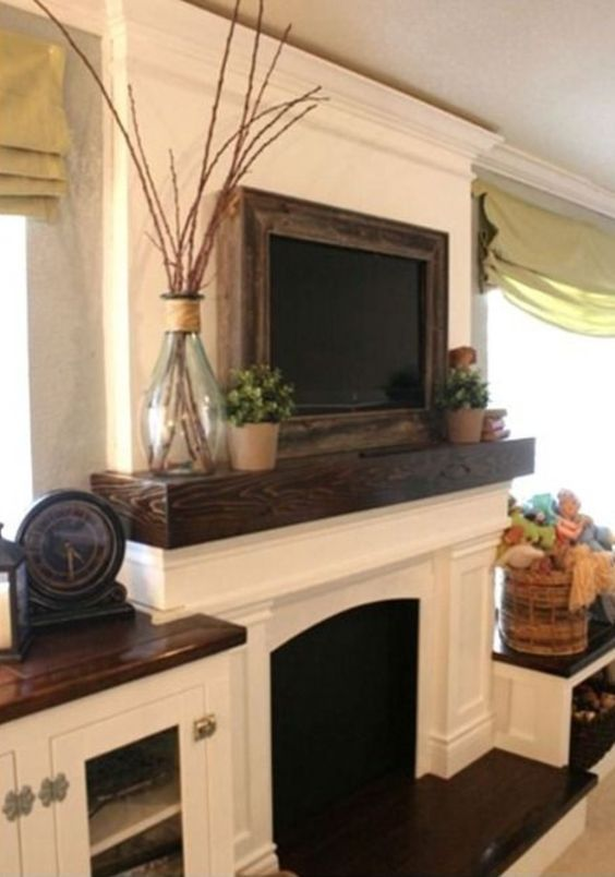 I always thought that dark colors were needed on the wall to balance out a flatscreen TV, but wall hangings that blend in with the wall fill up the space without distracting the eye from TV viewing. Pinned from: 9 Ways to Design Around a TV.