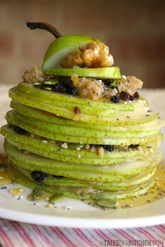 Awesome fruity breakfast or afternoon snack: fresh pear mille feuille layered up with raw walnut butter, pepitas, sesame seeds, chia seeds and honey.