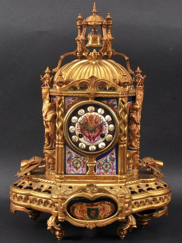 A Good 19th Century French Ormolu And Sevres Porcelain Mantle Clock of Gothic Inspiration.