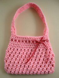 The Bobble-licious Bag is an adorable crochet pattern that uses the bobble stitch to create a great purse, perfect for dress up and play time.