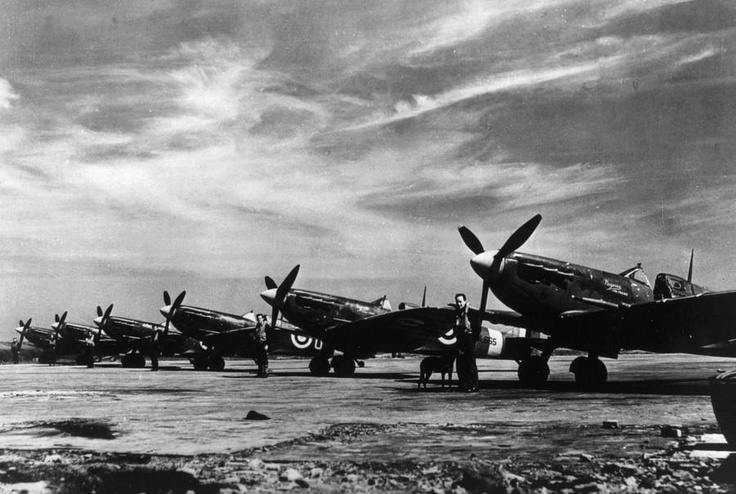 """British Spitfire fighter planes lined up on the tarmac during the Battle of Britain, 1940-1941, waiting for the call to combat. The fighter pilots, English and of other nations, repelled Herman Goering's Luftwaffe. Churchill said it best: """"Never in the course of human endeavor have so many, owed so much, to so few."""""""
