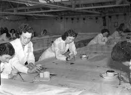 Old Bleach Linen Factory workers hand painting the Linen. Randalstown, Co. Antrim, Northern Ireland. The largest producer of fine Irish linen.