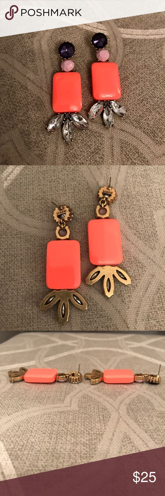 "J. CREW STATEMENT EARRINGS Gorgeous J. Crew statement earrings | Make any outfit pop with these | Bright coral/pink acrylic rectangles with lavender, purple, gray and clear gems | All gems in tact | Purple gem is crooked on one earring, but not loose and not noticeable looking straight on at the earring (see last photo) | Gems are in a gold/bronze setting | Do not have original backs to earrings | Great used condition, some marks on sides/ backs of earrings | Approx. 3"" long top to bottom J…"