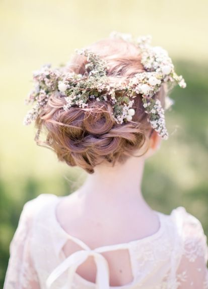 Flower girl updo with flower crown.