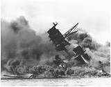 The USS Arizona (BB-39) burning after the Japanese attack on Pearl Harbor. (December 7, 1941)