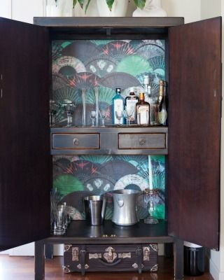 Even the drinks cabinet has been wallpapered.