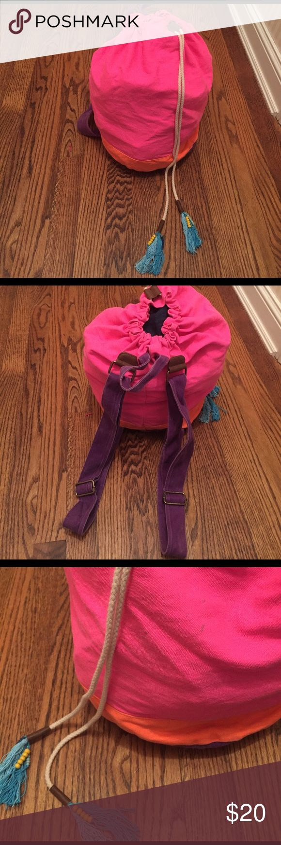Festival backpack Pink orange and purple canvas drawstring backpack with blue fringe tassel pulls.. perfect bag for festivals. Good conditions with a few spots as pictured. Bought from Target Mossimo Supply Co Bags Backpacks